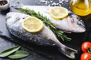 Fresh sea fish on slate board