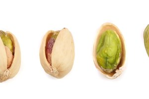 Pistachios isolated on white background, top view. Set or collection