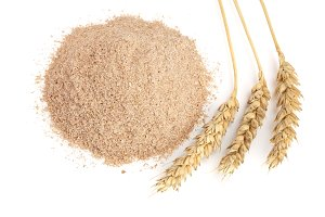 Pile of wheat bran with ears isolated on white background