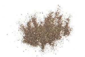 Ground black pepper isolated on white background. Top view