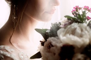 Bride looks awesome holding bouquet