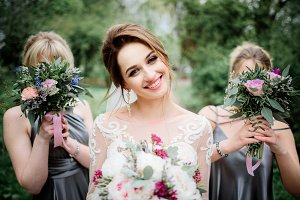 Pretty bride and bridesmaids pose