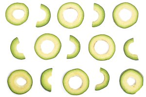 slices of avocado isolated on white background. Top view. Flat lay pattern