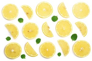 Slices lemon with mint leaves isolated on white background. Flat lay, top view