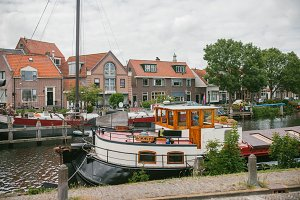 View of the old canal boats and the city. Netherlands