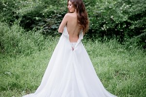 Bride taking off her dress