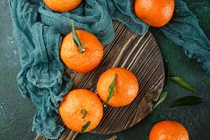 Tangerines (oranges, mandarins, clementines, citrus fruits) with leaves