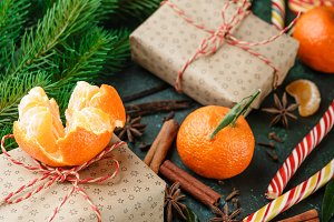 Cinnamon, candy canes and tangerines with leaves