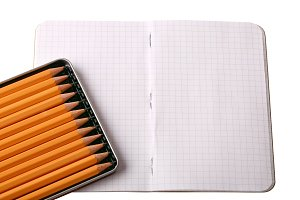 notebook set of black sketch pencils isolated on a white background