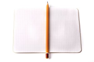 notebook black pencil isolated on white background
