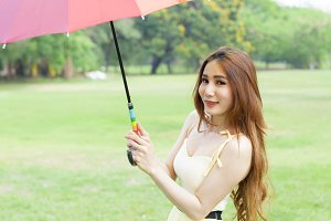 Woman with umbrella standing