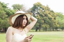 Woman play smart phone.