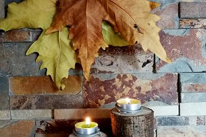 Burning candles and dry leaves