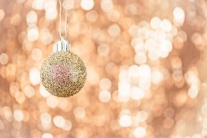 Christmas ball on abstract shimmering bokeh background