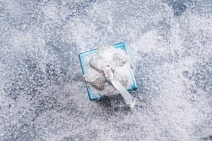 Decorative gift box on snowy background