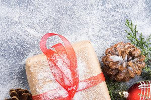 Christmas new year gift with ribbon and snow