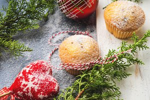 Christmas baking muffins with icing sugar