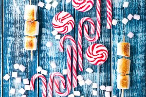 Candy cane over a blue background