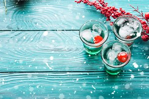 Christmas party green drink with ice and cherry