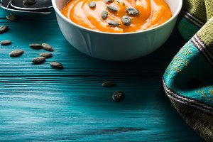 Creamy pumpkin soup in white bowls