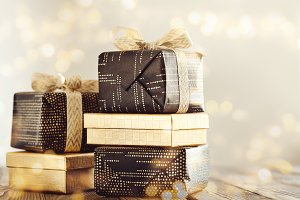 Wrapped presents in shining sparkles