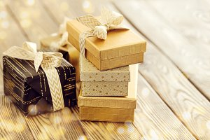 Golden gifts on wooden table