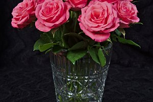 Bouquet of red roses in a glass vase