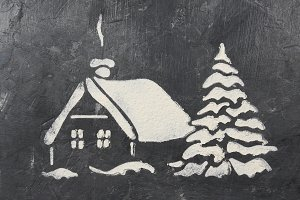 A trace from a stencil in the form of a Christmas tree and a house of flour on a gray concrete background. Ideas for festive baking and decorating.