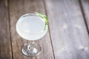 Sweet cocktail with rosemary