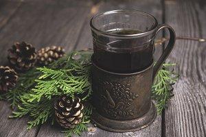 Black tea in retro cup holder