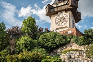 Low angle view of Uhrturm clock in Graz