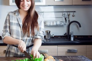 young woman slicing a salad for your
