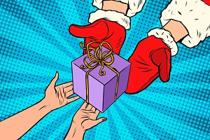 Santa Claus gives Christmas gift