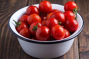 Cherry tomatoes in enamel bowl