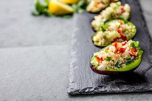 Tradition peruvian quinua quinoa salad served in avocado half, slate board