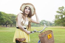 Woman with bike on the lawn