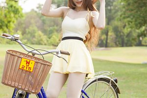 Asian woman riding a bicycle