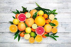 Assorted fresh citrus fruits with le