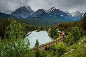 Train passing through Morant's Curve in bow valley, Banff National Park