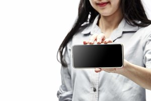 woman hand hold and touch screen sma