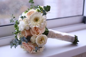 bridal bouquet in vase on windowsill close up