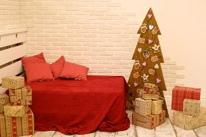 christmas tree with red bed and pillows cozy interior