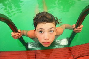 teen boy in swimming pool close up photo
