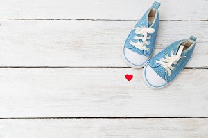 Children's sneakers and a red heart