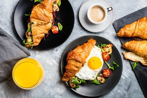 Croissant sandwiches with Fried Egg, Salad Leaves, Grilled Mushr