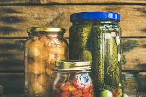 Autumn pickled vegetables in glass jars, copy space, square crop