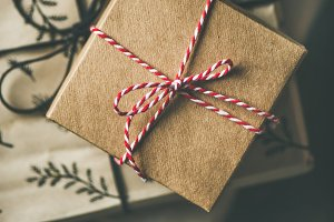 Flat-lay of gift boxes, rope, scissors, square crop