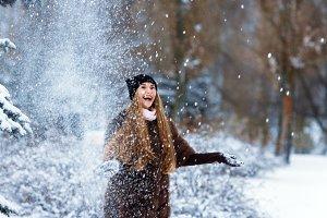 Beautiful smiling girl in a fur coat