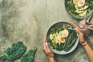 Quinoa, kale, beans, avocado, egg bowls, copy space
