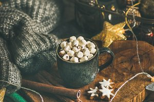 Christmas winter hot chocolate with marshmellows and cinnamon sticks